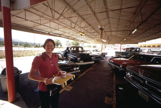 A waitress at the local A&W Drive-In is saving her earnings for out-of-town schooling, July 1973. (Photo by David Hiser/NARA via The Atlantic)