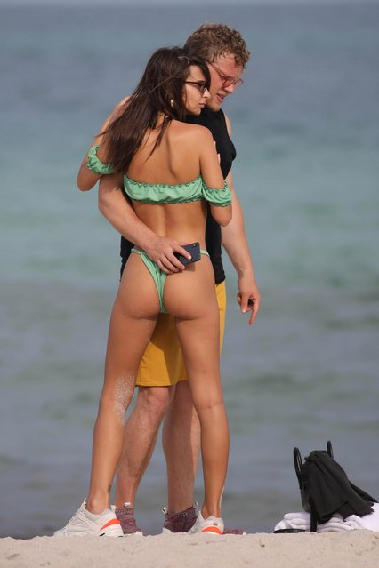 Emily Ratajkowski and her husband Sebastian Bear-McClard are seen with friends on the beach in Miami, USA on July 22, 2018. (Photo by The Mega Agency)