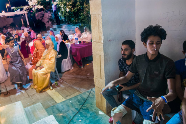 """Guesmi at his sister's wedding. """"My family is so important to me"""", he says. """"It is a long road so I must be surrounded by good people who inspire me"""". (Photo by Yassine Alaoui Ismaili/The Guardian)"""