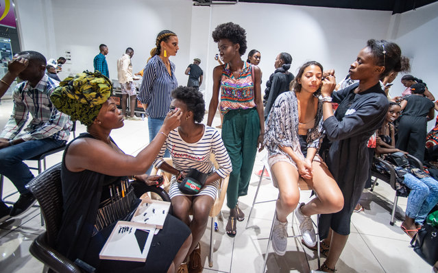"One tagline of fashion week was: ""Congo: au royaume des sapeurs"" (""the kingdom of the sapeurs""). (Photo by Olivia Acland/The Guardian)"