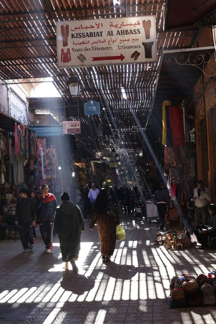 People walk through an alley of a traditional souk in the old Medina of Marrakesh December 19, 2014. (Photo by Youssef Boudlal/Reuters)