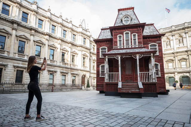 "Cornelia Parker's Transitional Object ""Psychobarn"" at the Royal Academy of Артс ин  London, UK on September 17, 2018. Standing at nearly 30 feet (10m), it is made from the components of a dismantled traditional American red barn and is based on the house seen in Alfred Hitchcock's film Psycho (1960), which in turn was modelled on a painting by the American painter Edward Hopper, House by the Railroad, 1925. (Photo by Guy Corbishley/Alamy Live News)"