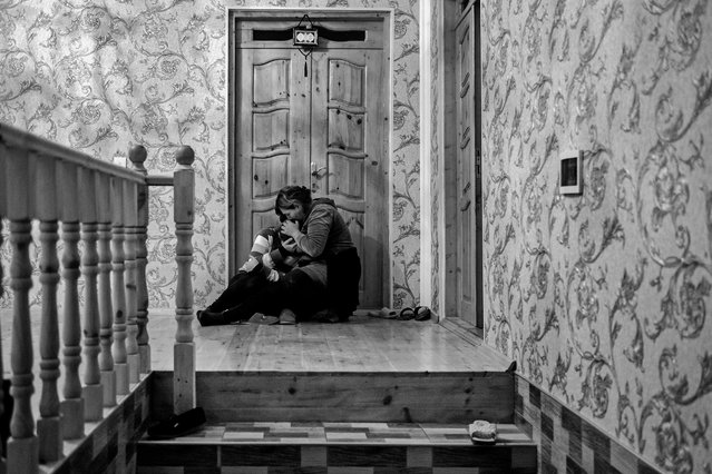 News Story Second Prize. A woman grieves the death of her mother who was killed in an attack on the village of Karayusuflu, in the Barda district of Azerbaijan. (Photo by Ugur Yildirim/Istanbul Photo Awards 2021)
