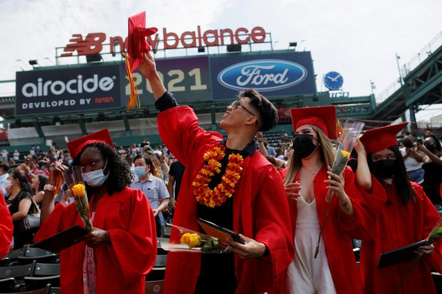 High school seniors celebrate after receiving their diplomas as the Josiah Quincy Upper School held its graduation ceremonies at Fenway Park, home of Major League Baseball's Boston Red Sox, for greater safety during the coronavirus disease (COVID-19) pandemic, in Boston, Massachusetts, U.S., June 8, 2021. (Photo by Brian Snyder/Reuters)
