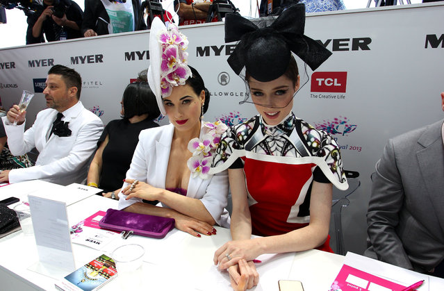 Dita von Teese (L) and model Coco Rocha look on during judging of Myer Fashions on the Field during Melbourne Cup Day at Flemington Racecourse on November 5, 2013 in Melbourne, Australia. (Photo by Lisa Maree Williams/Getty Images for the VRC)