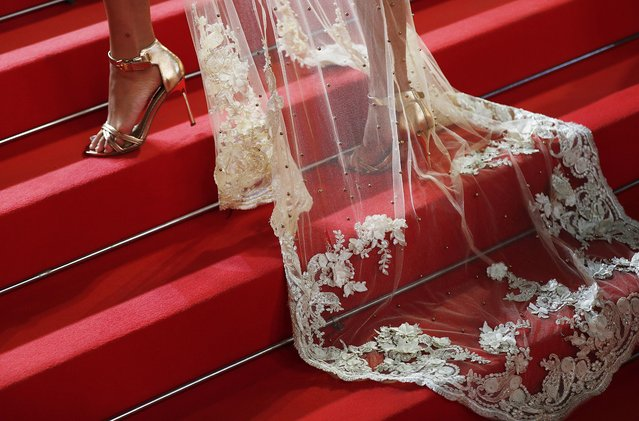 """The dress and shoes of Angelina Kali are seen in detail during  the """"Haut Et Fort (Casablanca Beats)"""" screening during the 74th annual Cannes Film Festival on July 15, 2021 in Cannes, France. (Photo by Johanna Geron/Reuters)"""