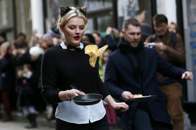 Participants take part in the annual Great Spitalfields Pancake Race in aid of London's Air Ambulance in London, Britain February 9, 2016. (Photo by Stefan Wermuth/Reuters)