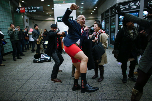 "A man without pants dances in a subway station during the ""No Pants Subway Ride"" in New York on January 8, 2017. (Photo by Kena Betancur/AFP Photo)"