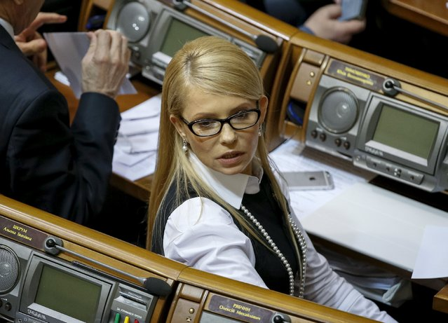 """Ukrainian former Prime Minister and leader of Batkivshchyna (Fatherland) party Yulia Tymoshenko attends a parliament session in Kiev, Ukraine, February 16, 2016. A junior ally in Ukraine's ruling coalition quit on Wednesday, calling the alliance a """"facade"""" and demanding an overhaul of the way the country was run. """"Yesterday extraordinary events took place in parliament"""", party leader of the Fatherland faction Yulia Tymoshenko said, urging other lawmakers to walk out of the coalition as well. (Photo by Gleb Garanich/Reuters)"""