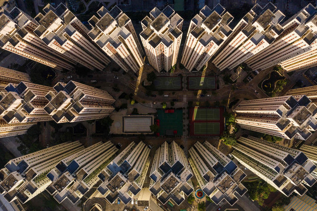 This aerial photo taken on December 21, 2018 shows a highrise residential housing estate in Hong Kong. (Photo by Dale De La Rey/AFP Photo)