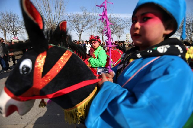 Chinese folk entertainers perform during a parade event to celebrate the Chinese traditional Lantern Festival in rural Zhangjiakou city, Yu Country, Hebei province, China, 22 February 2016. The festival marks the end of the lunar new year celebrations. (Photo by Wu Hong/EPA)