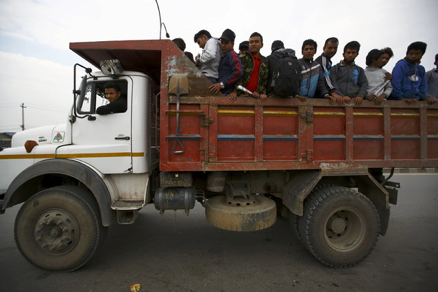 Nepalese people leave for their villages riding on a truck due to the lack of public transportation a day after an earthquake in Bhaktapur, Nepal April 26, 2015. (Photo by Navesh Chitrakar/Reuters)