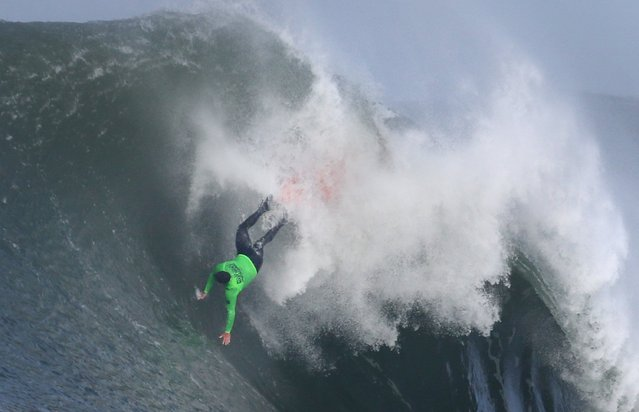 Ben Wilkinson wipes out on a wave in the third heat of Round 1 during the Mavericks Big Wave Invitational surfing contest at Half Moon Bay, Calif., on Friday, January 24, 2014. (Photo by Patrick Tehan/Bay Area News Group/MCT)
