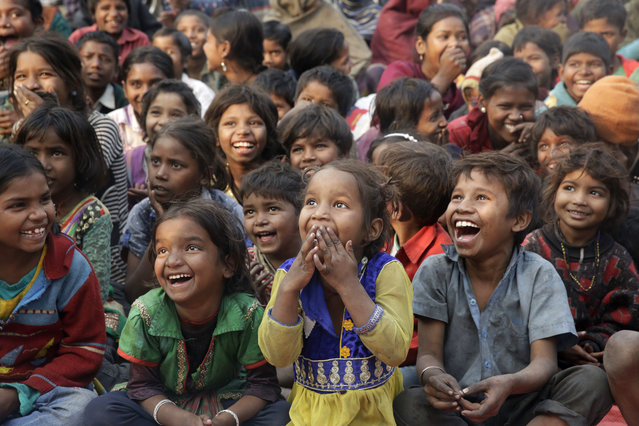 Impoverished Indian children watch a performance as part of advocacy against child labor in Allahabad, India, Tuesday, January 17, 2017. Despite the country's rapid economic growth, child labor remains widespread in India, where an estimated 13 million children work, with laws meant to keep kids in school and out of the workplace routinely flouted. (Photo by Rajesh Kumar Singh/AP Photo)