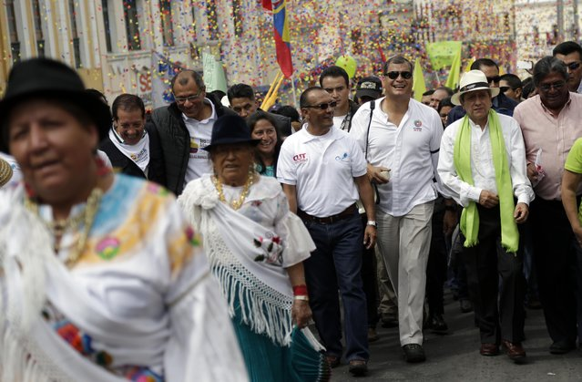 Ecuador's President Rafael Correa, third from the right, marches in the May Day parade in Quito, Ecuador, Friday, May 1, 2015. (Photo by Dolores Ochoa/AP Photo)