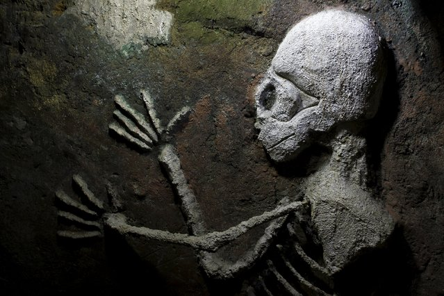 A figure of a skeleton is seen painted in a hallway of the house built underground by Manuel Barrantes in San Isidro de Perez Zeledon, Costa Rica, March 14, 2016. (Photo by Juan Carlos Ulate/Reuters)