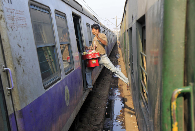 A vendor moves from one train to another at a railway station in Kolkata February 12, 2014. India's Railway Minister Mallikarjun Kharge will present an interim railway budget for 2014/15 fiscal year beginning April on Wednesday. (Photo by Rupak De Chowdhuri/Reuters)