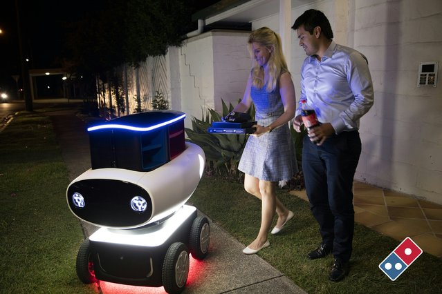 An undated handout photo received on March 18, 2016, shows fast food giant Domino's new trial pizza delivery robot in New Zealand, describing the hi-tech, driverless units as a world first. In a move enthusiastically backed by the New Zealand government, Domino's said it was working with authorities on plans to roll out its DRU (Domino's Robotic Unit). The four-wheeler, developed in Australia, is just under a metre (three foot) high and contains a heated compartment that can hold up to 10 pizzas. (Photo by AFP Photo/Stringer)