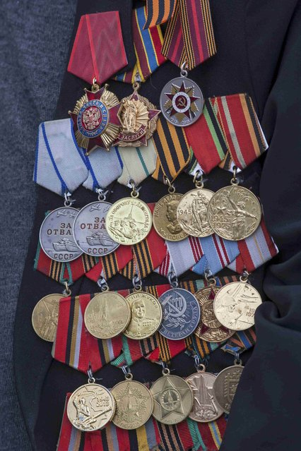 Military decorations of a World War Two veteran are pictured during the Victory Day celebrations in Petrozavodsk, Russia, May 9, 2015. (Photo by Reuters/Host Photo Agency/RIA Novosti)