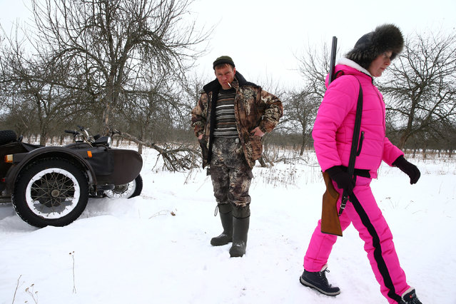 Vladimir Krivenchik, a hunter, and his wife Nina Skidan are seen after hunting for a wolf near the village of Khrapkovo, Belarus February 1, 2017. (Photo by Vasily Fedosenko/Reuters)