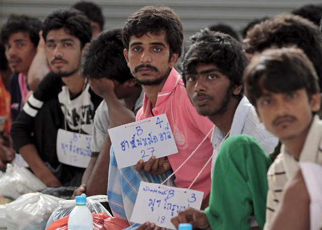 Suspected Rohingya migrants from Myanmar and Bangladesh rest at Rattaphum district hall in Thailand's southern Songkhla province May 9, 2015. (Photo by Surapan Boonthanom/Reuters)