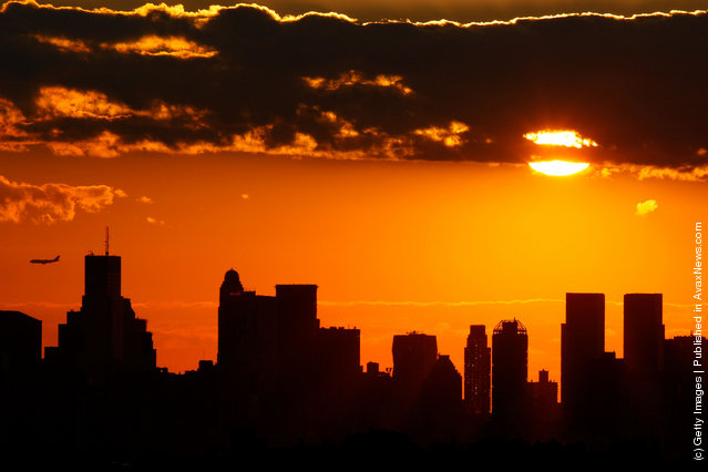 The sun sets over Manhattan