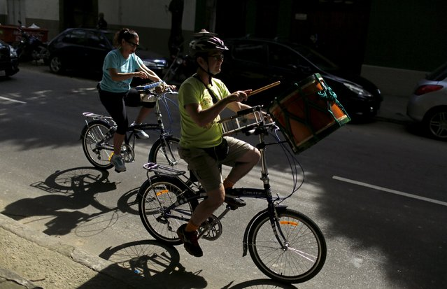 Members of the Cyclophonica band play instruments during a ride in Rio de Janeiro May 17, 2015. (Photo by Pilar Olivares/Reuters)