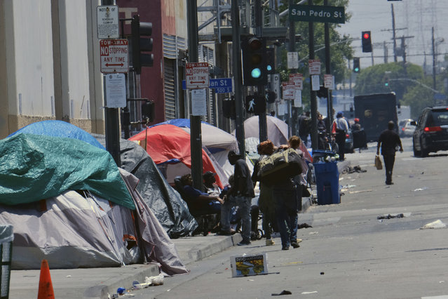Tents housing homeless line a street down the street from LAPD Central Community Police Station in downtown Los Angeles on Thursday, May 30, 2019. The union that represents the LAPD is demanding a cleanup of homeless encampments in the city after one detective who works downtown was diagnosed with typhoid fever and two others are showing similar symptoms. (Photo by Richard Vogel/AP Photo)