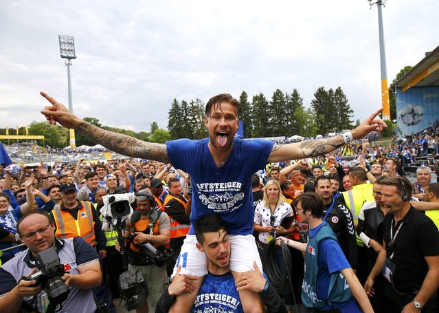 Damstadt's Tobias Kempe celebrates with fans after winning their German Bundesliga second division soccer match against Sankt Pauli in Darmstadt, Germany, May 24, 2015. (Photo by Kai Pfaffenbach/Reuters)