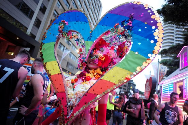 A woman wears a giant rainbow coloured heart as her outfit during the annual Sydney Gay and Lesbian Mardi Gras festival in Sydney, Australia March 4, 2017. (Photo by Jason Reed/Reuters)
