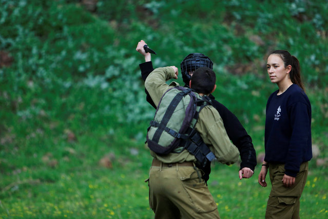 Female Israeli soldier, Lotem Stapleton (R), a physical education officer, oversees a training session in Krav Maga, an Israeli self-defence technique, at a military base in the Israeli-occupied Golan Heights March 1, 2017. (Photo by Nir Elias/Reuters)