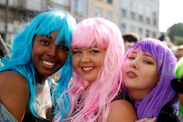 Participants pose for a portrait during the Gay Pride Parade in downtown Lisbon, Portugal on June 29, 2019. (Photo by Rafael Marchante/Reuters)