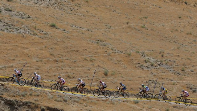 Athletes compete during the mountain bike competition at the 2015 European Games in Baku, Azerbaijan, Saturday, June 13, 2015. (AP Photo/Dmitry Lovetsky)