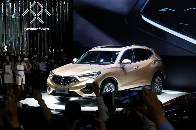 Visitors take pictures of Acura CDX SUV at its launching ceremony during the Auto China 2016 auto show in Beijing, April 25, 2016. (Photo by Kim Kyung-Hoon/Reuters)