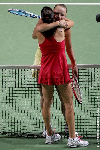 Caroline Wozniacki of Denmark hugs Agnieszka Radwanska of Poland