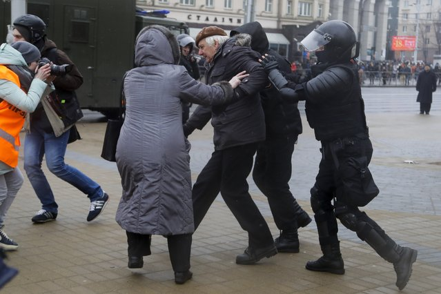 Belarus police detain a man, as a woman tries to defend him during an opposition rally in Minsk, Belarus, Saturday, March 25, 2017. (Photo by Sergei Grits/AP Photo)