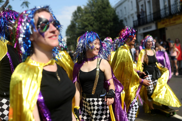 Revellers take part in the Notting Hill Carnival in London, Britain on August 25, 2019. (Photo by Simon Dawson/Reuters)