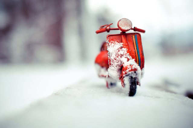"Red Vespa, ""Snow is Here"", Solothurn, Switzerland, November 2012. (Photo by Kim Leuenberger)"