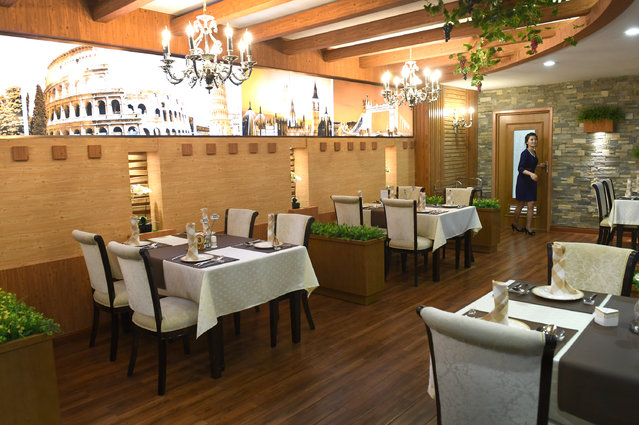"""View of a """"European"""" style restaurant inside the main airport in Pyongyang, North Korea on May 3, 2016. (Photo by Linda Davidson/The Washington Post)"""