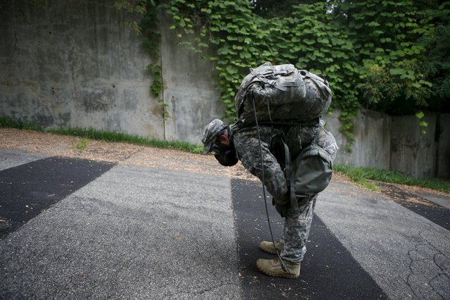 A soldier of the U.S. Army 23rd chemical battalion wearing a gas mask takes a deep breath as he gets left behind while on the march during a competition to test individual soldier skills at Camp Stanley in Uijeongbu, South Korea, July 8, 2015. (Photo by Kim Hong-Ji/Reuters)