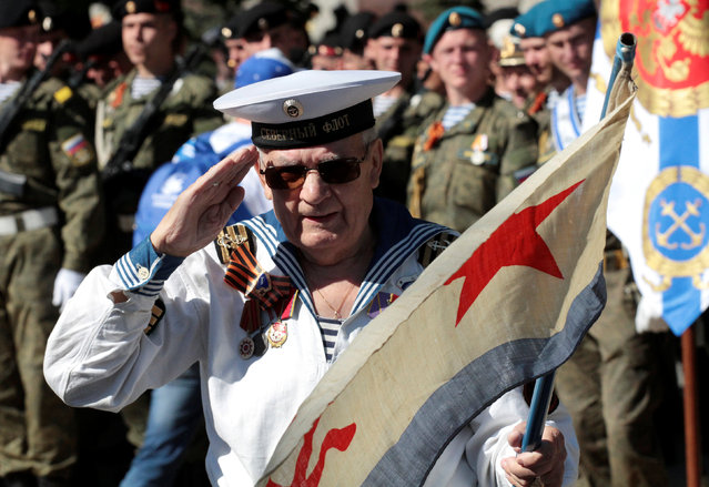 A man wearing a navy uniform attends the Victory Day parade, marking the 71st anniversary of the victory over Nazi Germany in World War Two, in the Black Sea port of Sevastopol, Crimea, May 9, 2016. (Photo by Pavel Rebrov/Reuters)