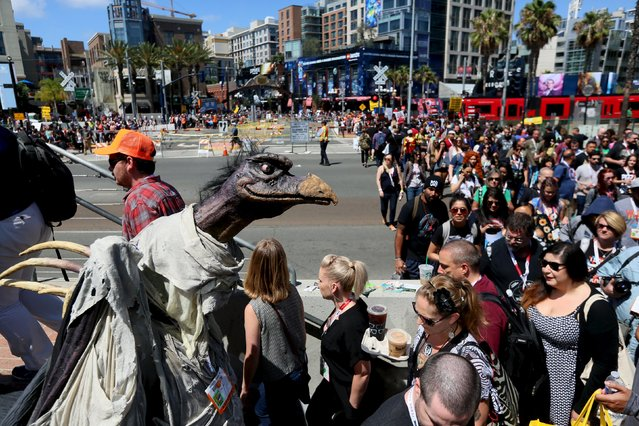 Attendees cross the street at the 2015 Comic-Con International in San Diego, California July 9, 2015. (Photo by Sandy Huffaker/Reuters)