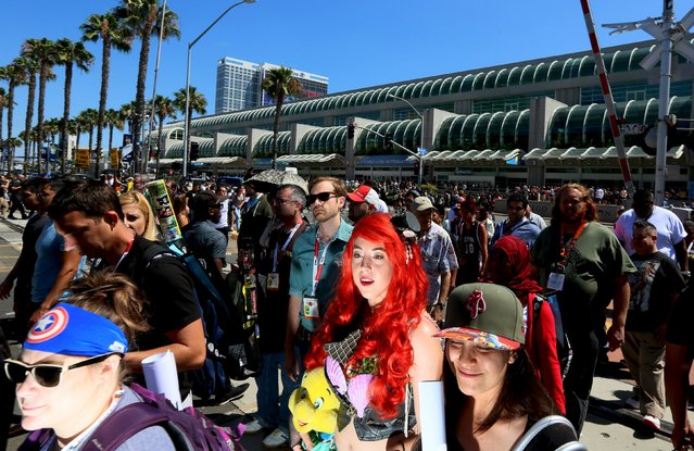 Cosplay enthusiasts walk outside the Convention Centerduring the 2015 Comic-Con International in San Diego, California July 10, 2015. (Photo by Sandy Huffaker/Reuters)