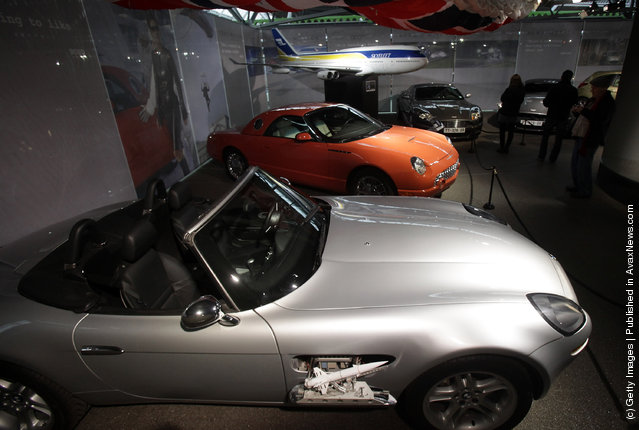 People look at cars including a BMW Z8 that was used in the James Bond film The World Is Not Enough currently displayed at the Bond In Motion exhibition
