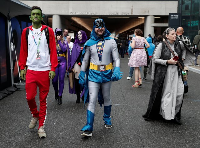 People dressed up in costume attend the 2019 New York Comic Con in New York City, New York, U.S., October 3, 2019. (Photo by Shannon Stapleton/Reuters)