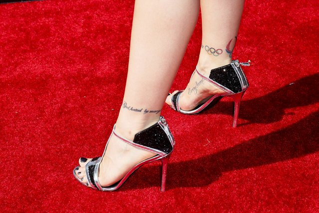 The shoes and tattoos UFC fighter Ronda Rousey are seen as she arrives for the 2015 ESPY Awards in Los Angeles, California July 15, 2015. (Photo by Danny Moloshok/Reuters)
