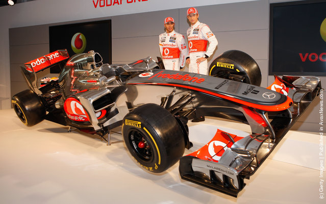 Team McLaren Mercedes drivers Lewis Hamilton (L) and Jenson Button unveil the new MP-27  Formula 1 car at the McLaren technology centre