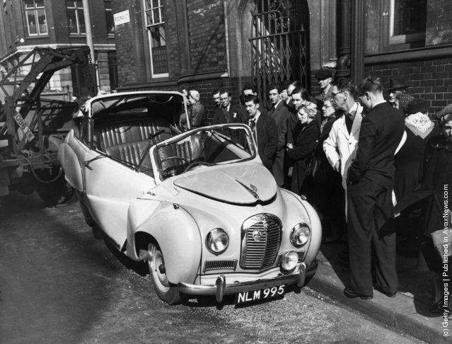 1954: An Austin A30 is towed away after losing a traffic argument with a Foden lorry in Clerkenwell