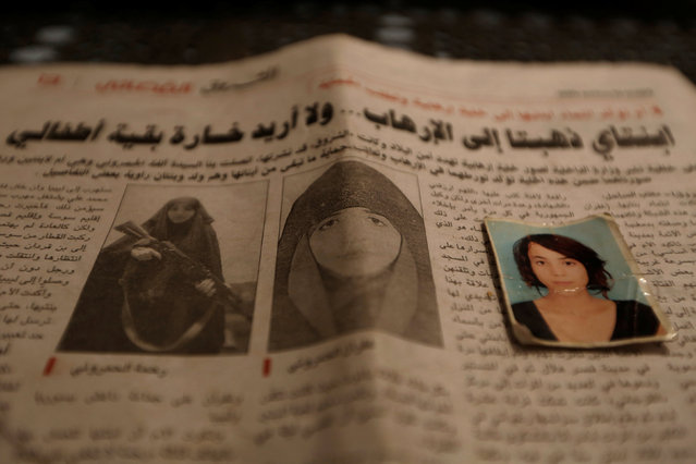 Photographs of Rahma (L), the wife of Noureddine Chouchane, a jihadist who was killed during a U.S strike in Libya, and her sister Gofran (R), are seen in a newspaper in Tunis, Tunisia April 14, 2016. (Photo by Zohra Bensemra/Reuters)