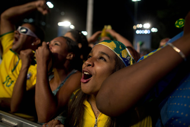 Fans celebrate after Brazil scored the second goal against Croatia during the opening match of the World Cup in Sao Paulo, Brazil, Thursday, June 12, 2014. (Photo by Dario Lopez-Mills/AP Photo)